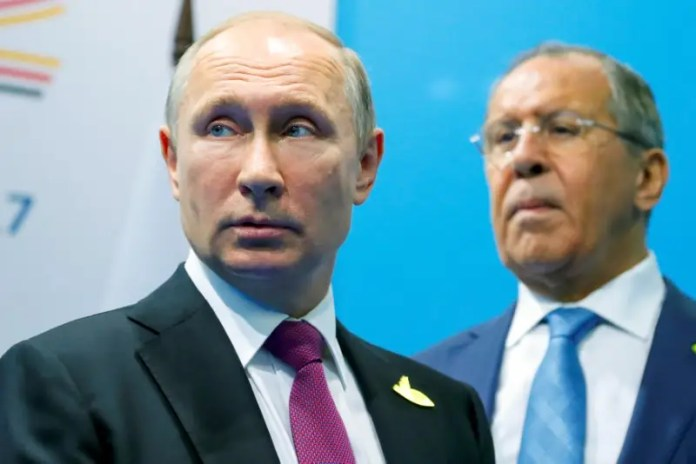 Russian President Vladimir Putin (L) and Foreign Minister Sergey Lavrov stand while waiting for Turkish President Tayyip Erdogan prior to their talks at the G-20 summit in Hamburg, Germany July 8, 2017.  REUTERS/Alexander Zemlianichenko/Pool Rosneft has been secretly helping Maduro stay afloat in Venezuela Rosneft has been secretly helping Maduro stay afloat in Venezuela ussia ready to help mediate in qatar row if asked lavrov