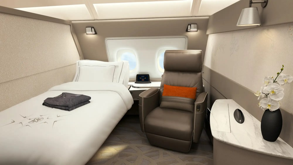 At the front of the top deck are six first new first class suites. Each private suite features a bed and a Poltrona Frau upholstered leather reclining swivel chair. When not in use, the bed can actually be stowed or converted to a sitting location.