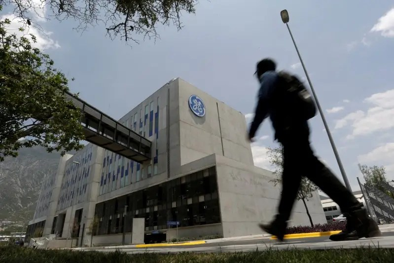 FILE PHOTO: A man walks past the Global Operations Center of General Electric Co. in San Pedro Garza Garcia, neighbouring Monterrey, Mexico, May 12, 2017. REUTERS/Daniel Becerril/File Photo