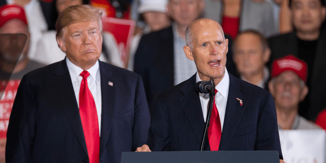 President Donald Trump and Florida Gov. Rick Scott.