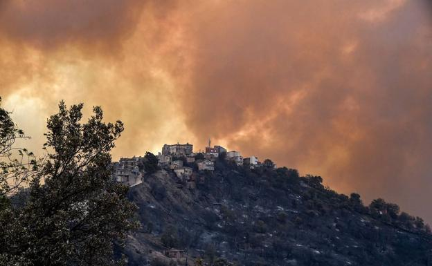 Smoke covers the sky east of the city of Algiers, Algeria.