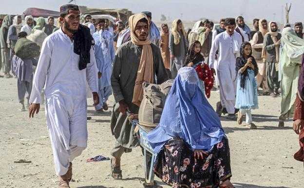 An Afghan family joins the stream of refugees moving through the territories that the Taliban have conquered.