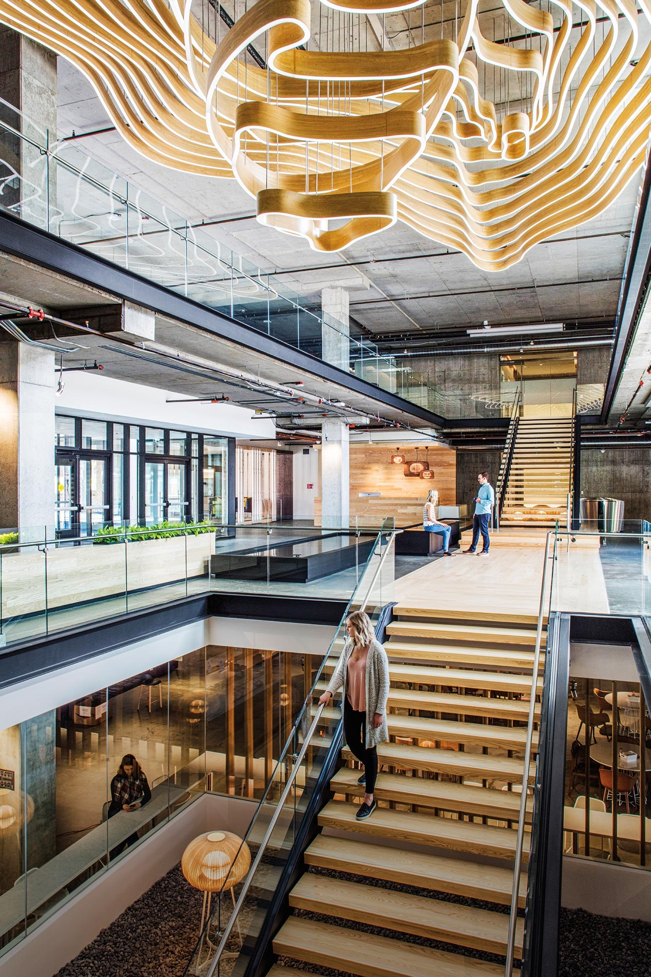 The New Shape Of Building Design Dialogue 34 Gensler | Staircase Design For Commercial Buildings | Cylindrical Glass | Enclosed | Beautiful | Central Staircase | Sleek