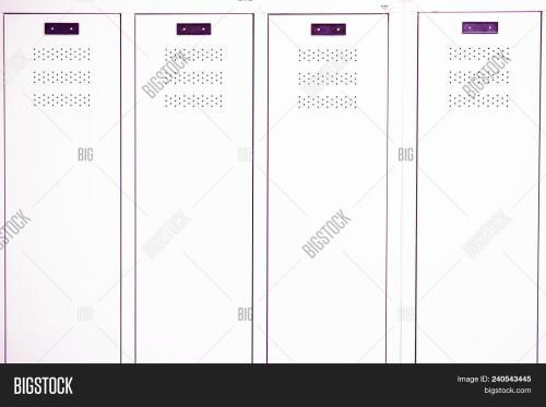 small resolution of white lockers in a gym locker room at school or university
