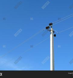 power line support isolated on blue sky background power pole with electrical wires and capacitors [ 1500 x 1245 Pixel ]