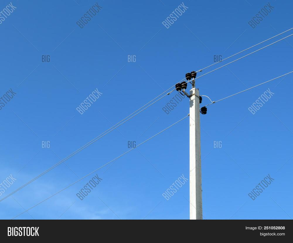 medium resolution of power line support isolated on blue sky background power pole with electrical wires and capacitors