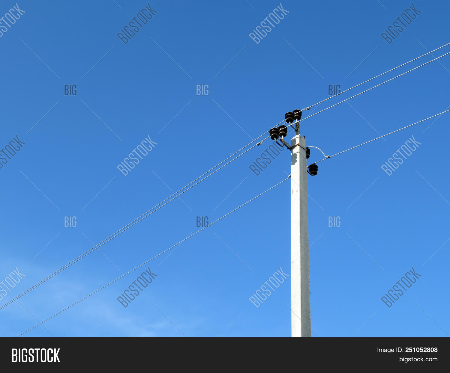 hight resolution of power line support isolated on blue sky background power pole with electrical wires and capacitors