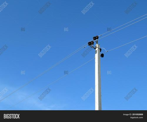 small resolution of power line support isolated on blue sky background power pole with electrical wires and capacitors