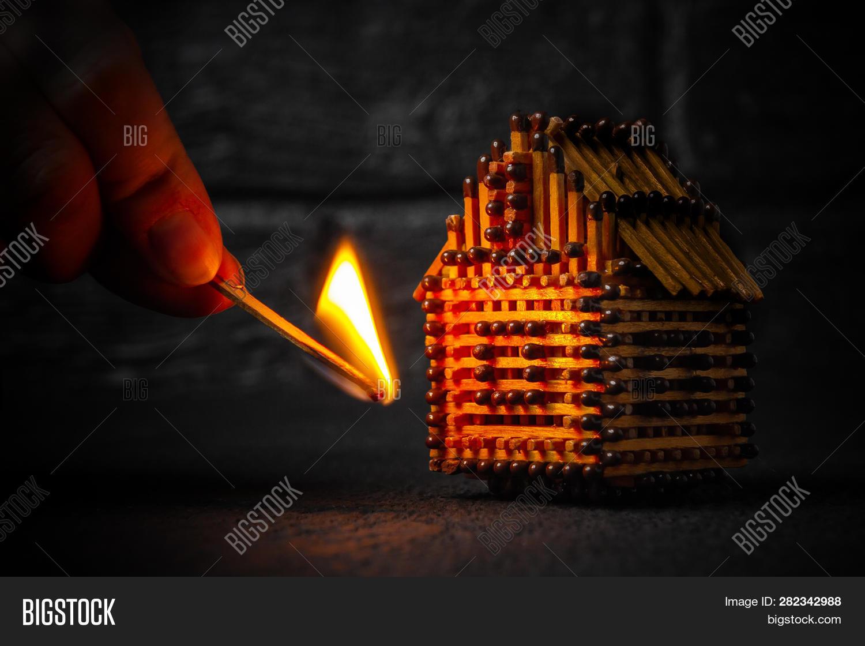 hand burning match image