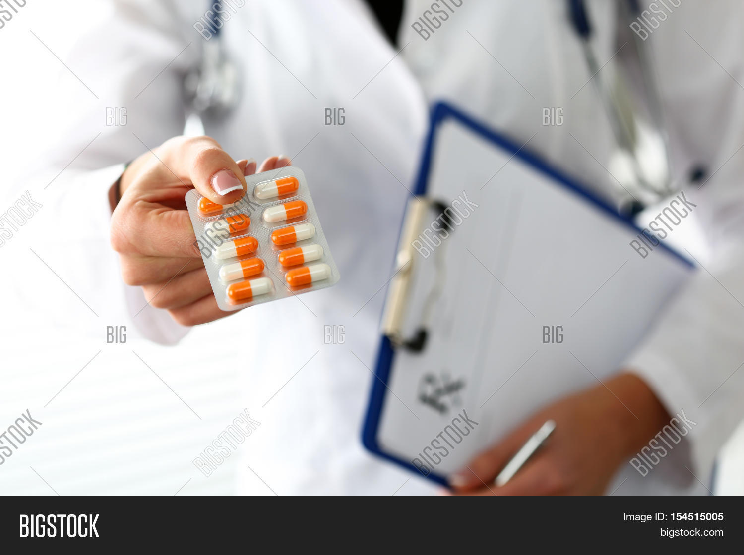 hight resolution of female doctor hand hold prescription on clipboard pad and offer to patient tablet blister panacea life save service prescribe medicament legal drug store