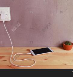 plug in power outlet adapter cord charger of mobile phone on wooden floor [ 1500 x 1120 Pixel ]