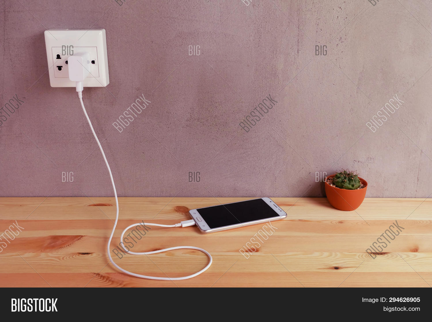 hight resolution of plug in power outlet adapter cord charger of mobile phone on wooden floor