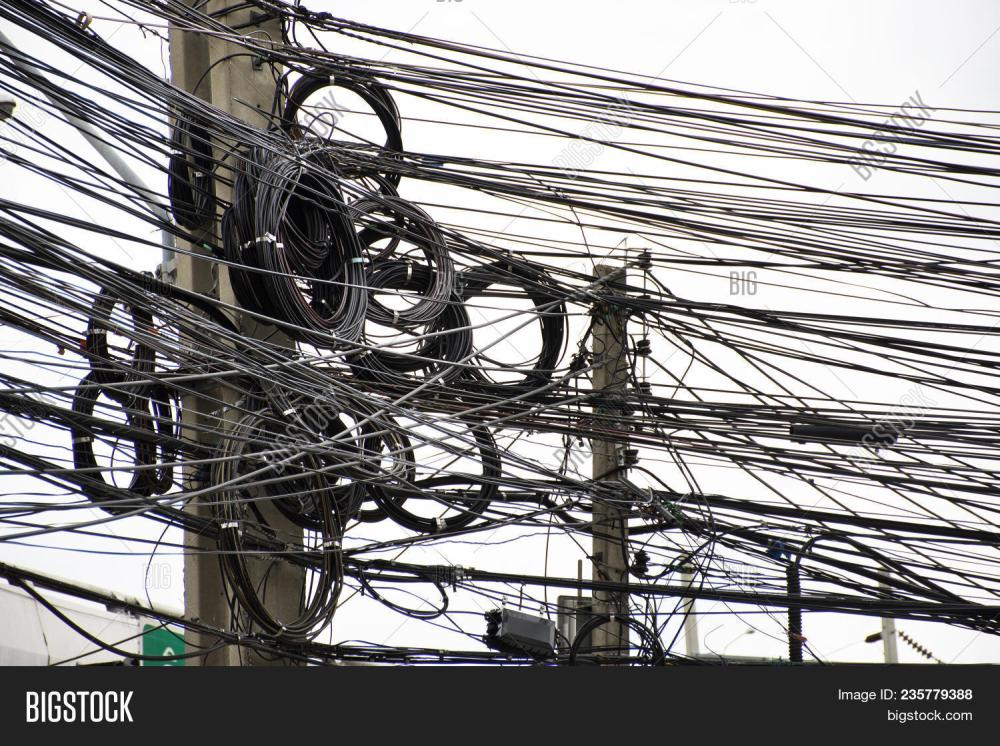 medium resolution of many wires messy with power line cables transformers and phone lines on old electricity pillar