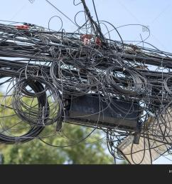 chaos of cables and wires on an electric pole many electrical cable wire and telephone line on electricity post thailand [ 1500 x 1120 Pixel ]