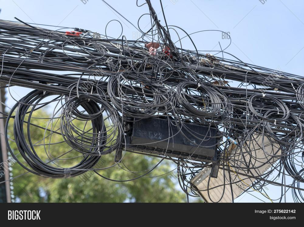 medium resolution of chaos of cables and wires on an electric pole many electrical cable wire and telephone line on electricity post thailand