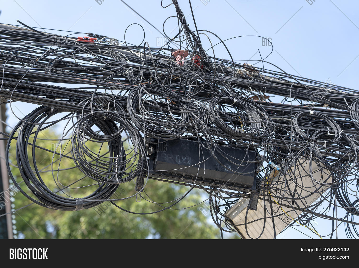 hight resolution of chaos of cables and wires on an electric pole many electrical cable wire and telephone line on electricity post thailand
