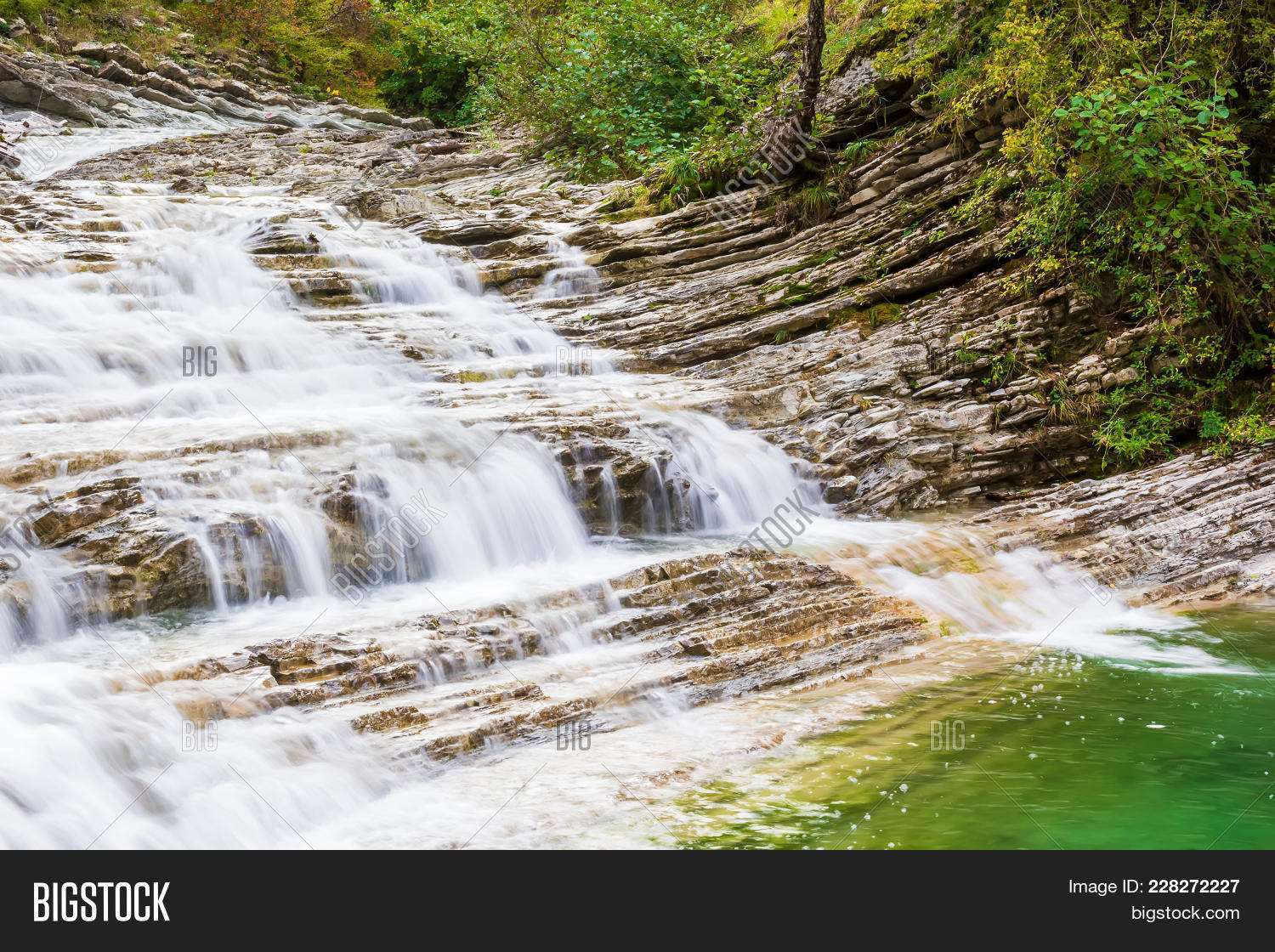 Waterfall at river PowerPoint Template - Waterfall at river ...