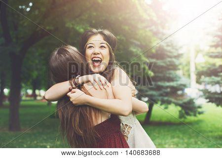 Two Happy Young Girls Hug Each Image & Photo   Bigstock
