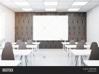 Contemporary grey classroom interior with empty whiteboard ...