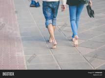 Happy Couple Walking Barefoot City Waterfront