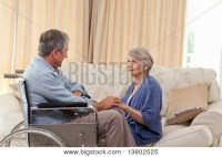 Senior couple talking in the living room at home Stock ...