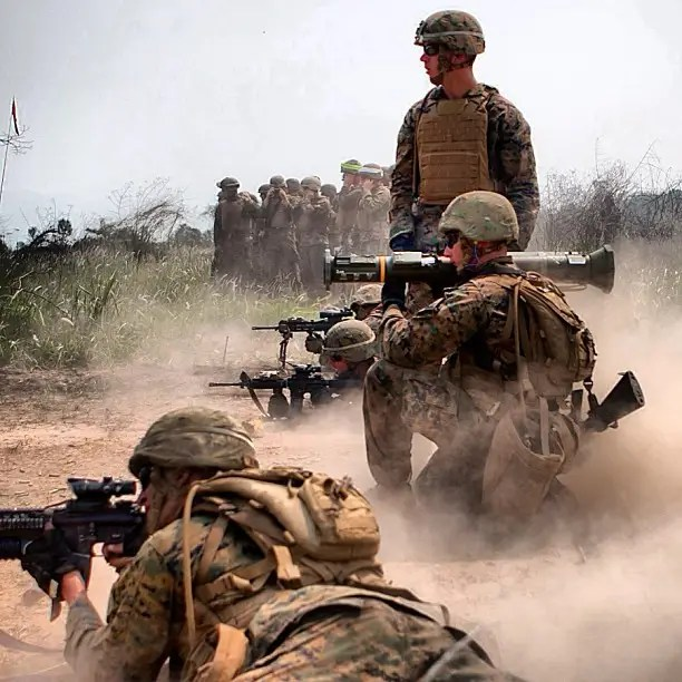 Marines doing live-fire rocket and small arms, earplugs necessary.