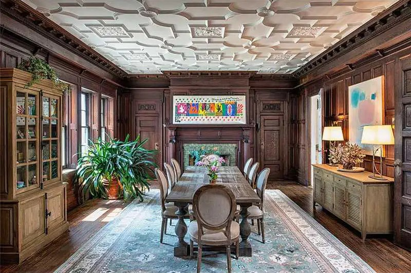 The dining room can easily fit eight guests and has a tracery ceiling.