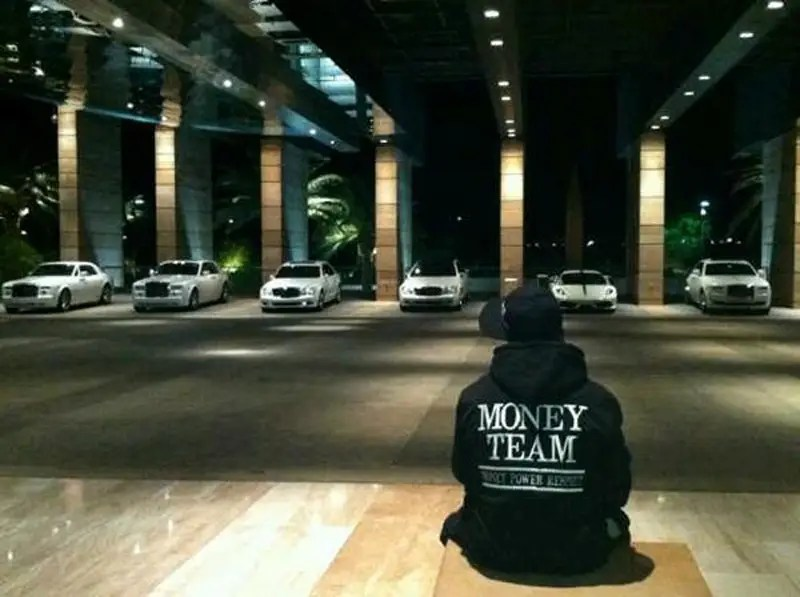 His full white car collection (he has a fleet of black luxury cars as well).
