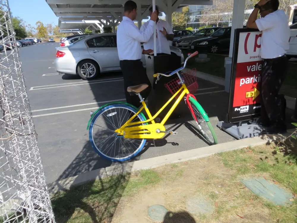 Google's color scheme is primary colors, used on everything, like these free campus bikes. Employees can use them to ride around the 'Plex. Don't want to ride? You can let these valets fetch and park your car for you.