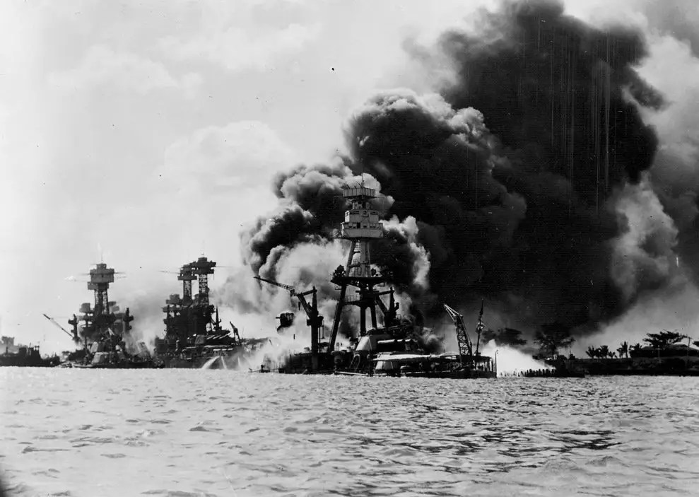 battleships aflame on battleship row alongside ford island