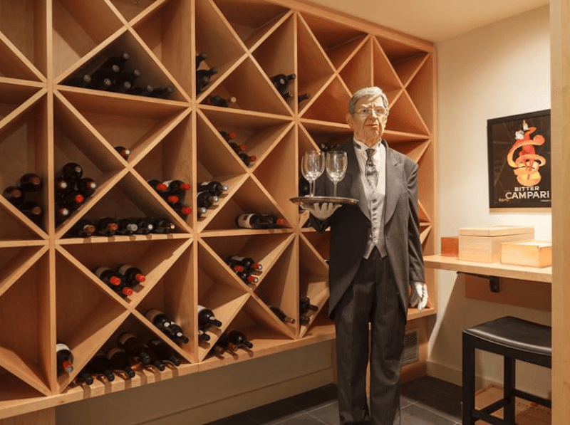According to the listing, the downstairs wine cellar has space for nearly 500 bottles, life-size butler statue included.