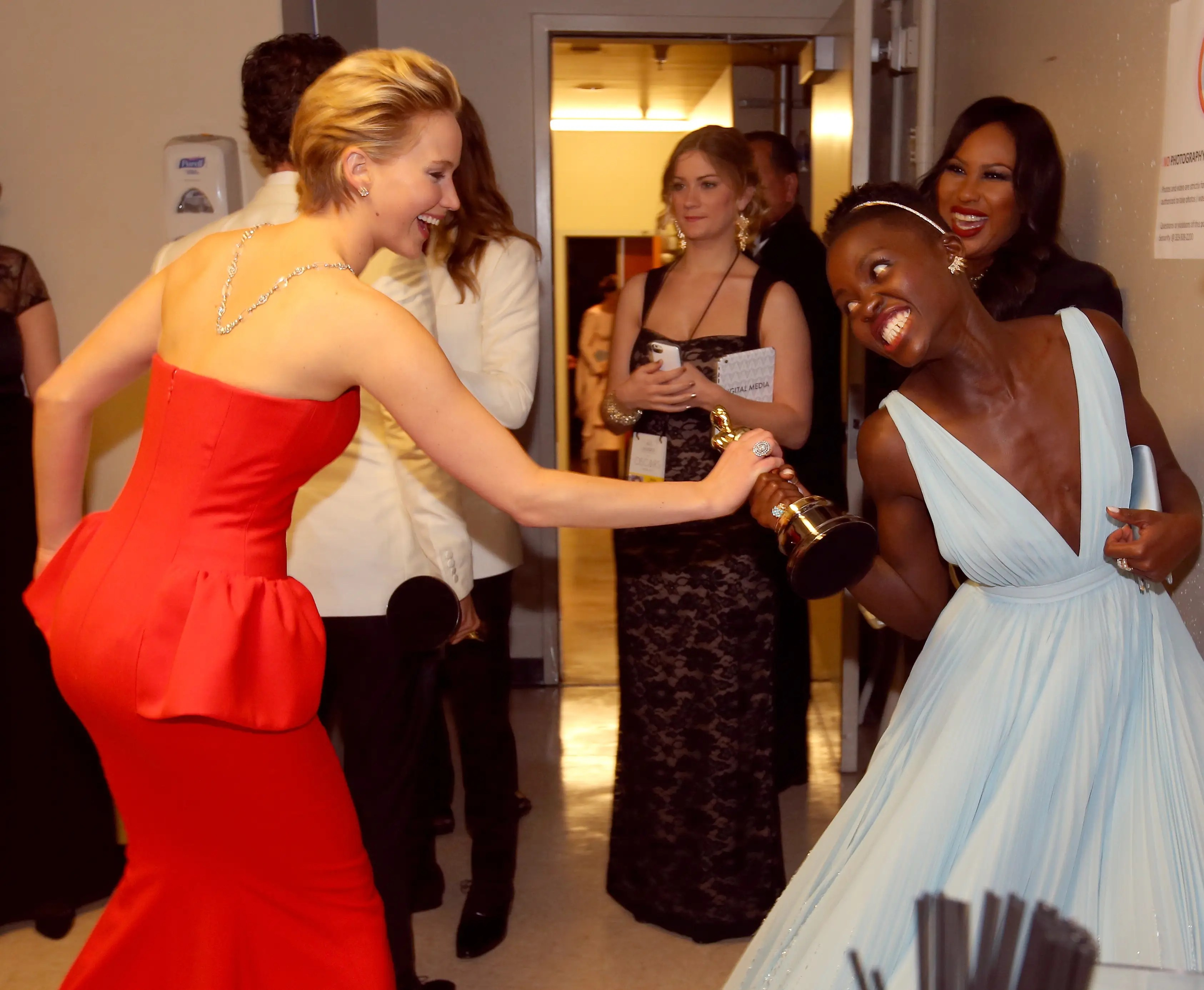 Jennifer Lawrence and Oscar winner Lupita Nyong'o playfully fought over the Best Supporting Actress Award backstage.