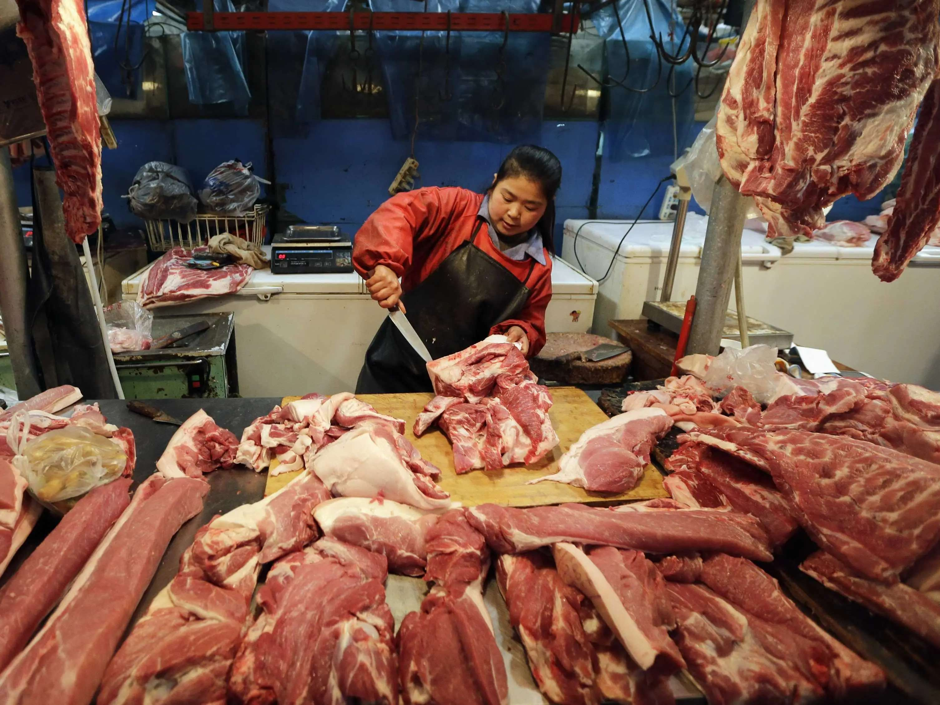China eats about 5,200 Eiffel towers' worth of pork a year.