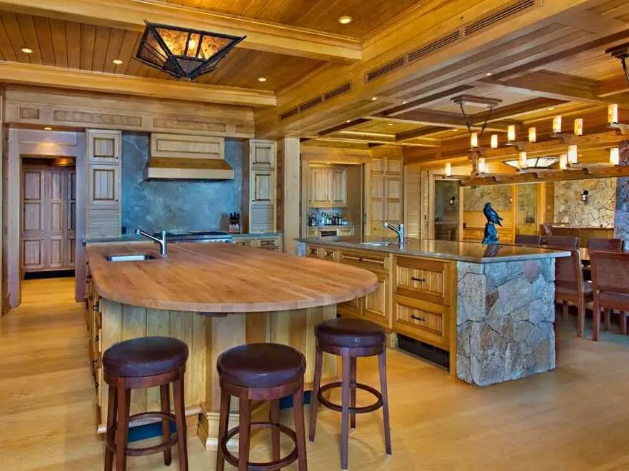 The kitchen is massive, with plenty of counter space and island seating.