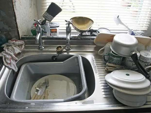 Garburator: an electric device underneath of a kitchen sink that breaks up food so it can be washed away. You call it a trash disposal.