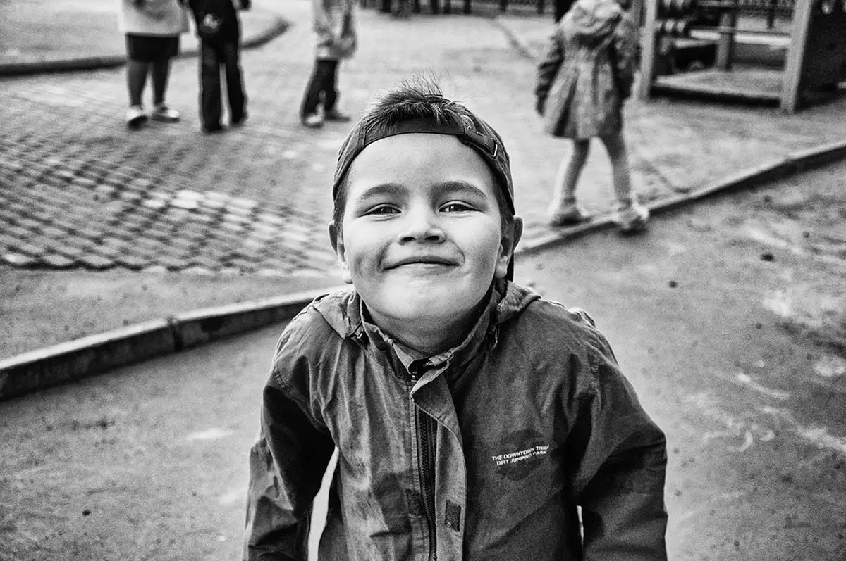 "Marat, age 5. Profession: Goes to kindergarten. Passion or Dream: ""I like playing with Transformers, and people reading books to me and playing computer games. I dream of becoming a policeman."""