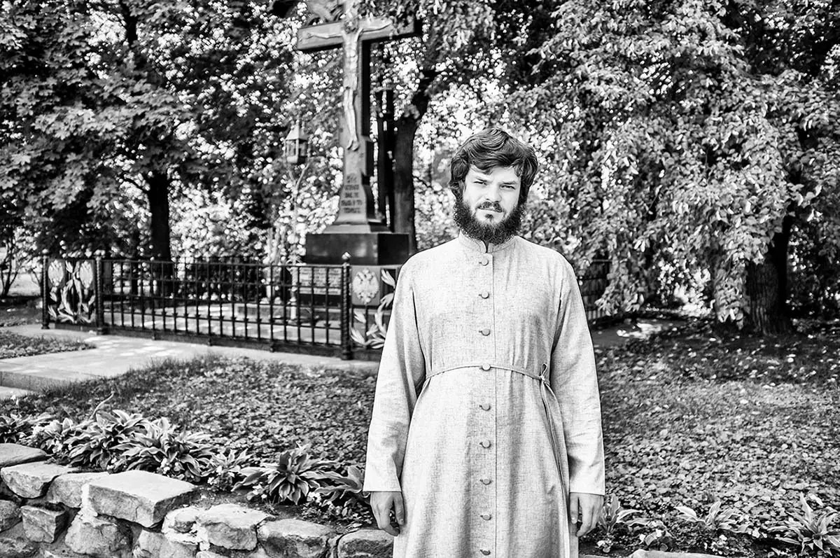 """Yuriy, age 27. Profession: Priest. Passion or Dream: """"I wish there were peace everywhere in the world."""""""