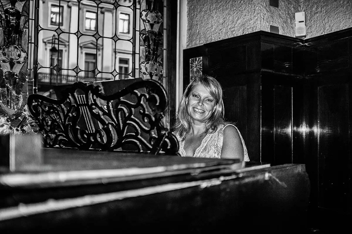 "Tatiana, age 47. Profession: Soloist and pianist. Passion or Dream: ""Music is my life. I would like to visit as many jazz festivals as possible."""