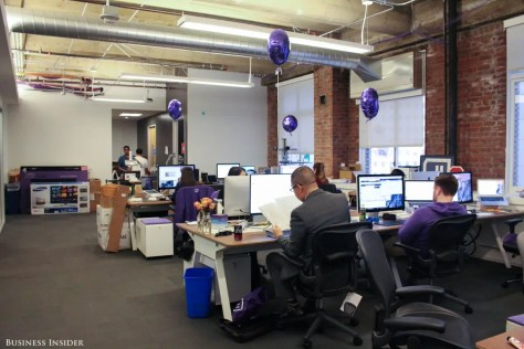Every employee gets a purple hoodie on their first day. The purple balloons mark where the newbies sit.