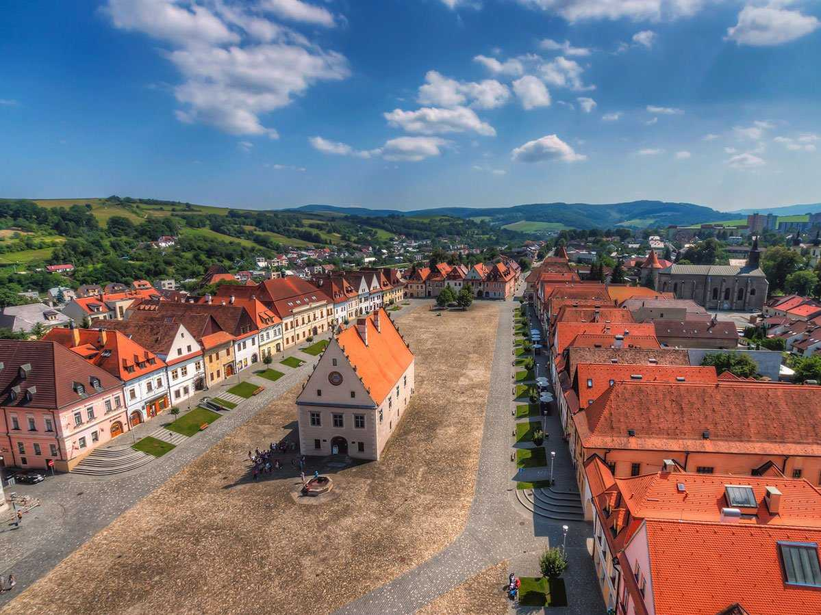 The fortified town of Bardejov sits on a floodplain terrace of the Topl'a River in Slovakia and stands as an example of a traditional trading town in Medieval Central Europe. The town hall was built in 1505, and the complex contains ritual baths and a small Jewish quarter surrounding the Great Synagogue, which was built in the 18th century.