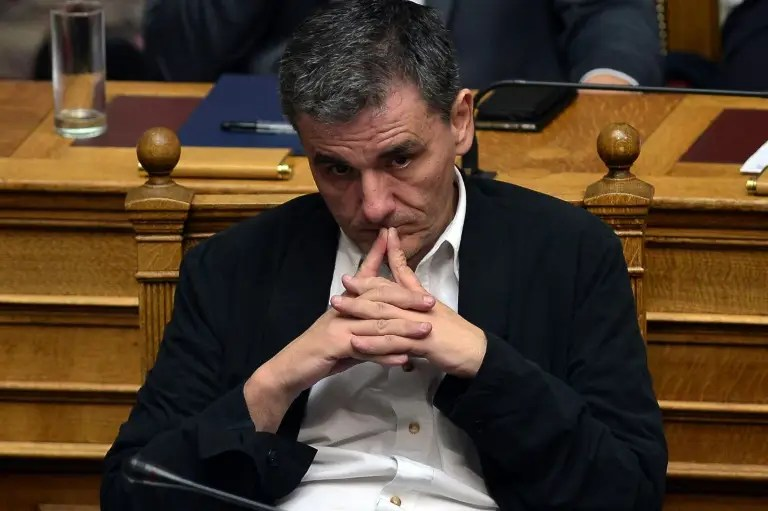 Greek Finance Minister Euclid Tsakalotos listens as Prime Minister Alexis Tsipras addresses a session at the Greek parliament in Athens on July 23, 2015