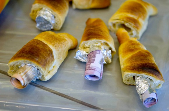 German customs agents foiled a money laundering operation after finding currency stuffed inside croissants.