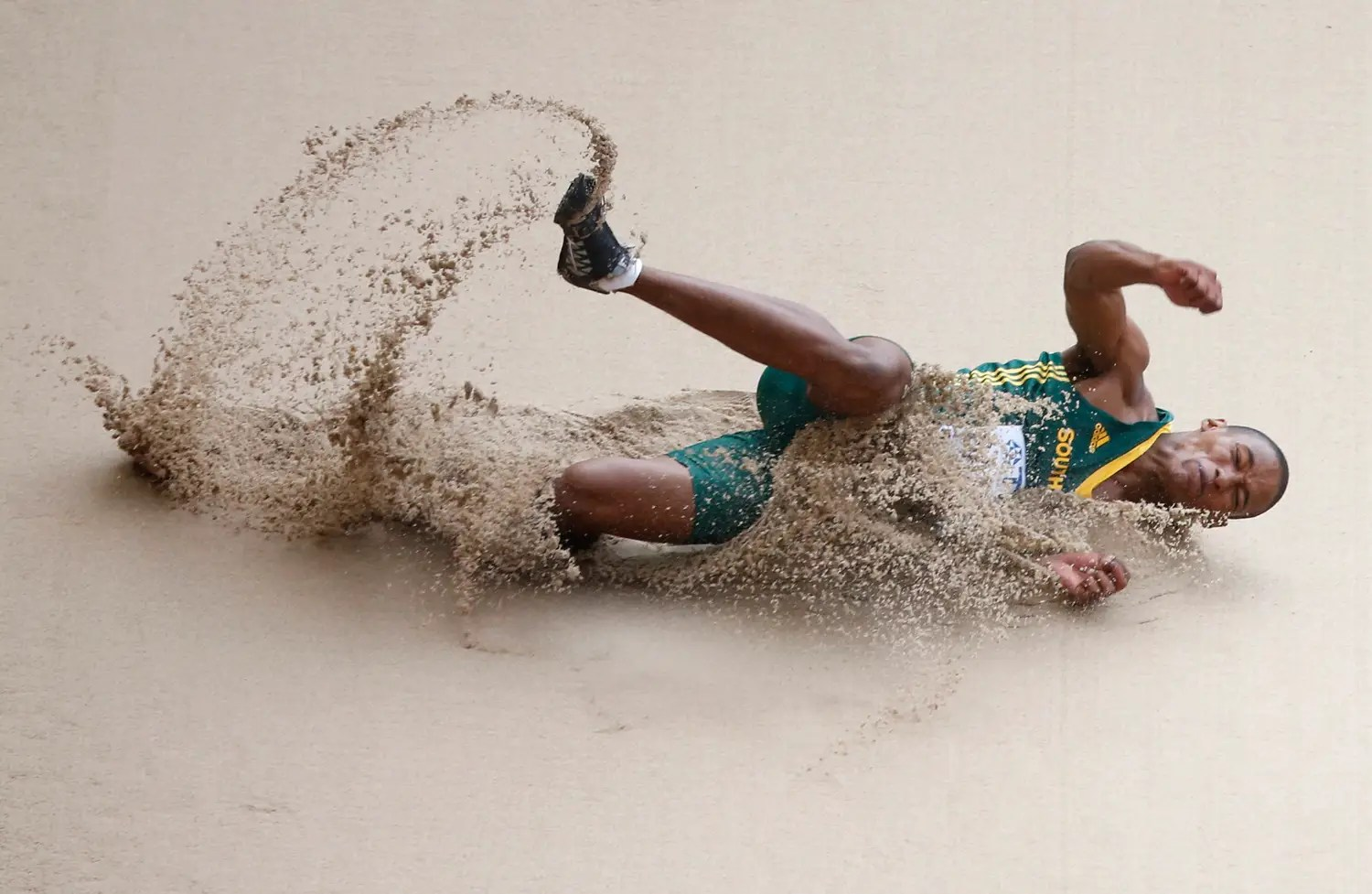 South African long jumper Rushwal Samaai lands in the sand.