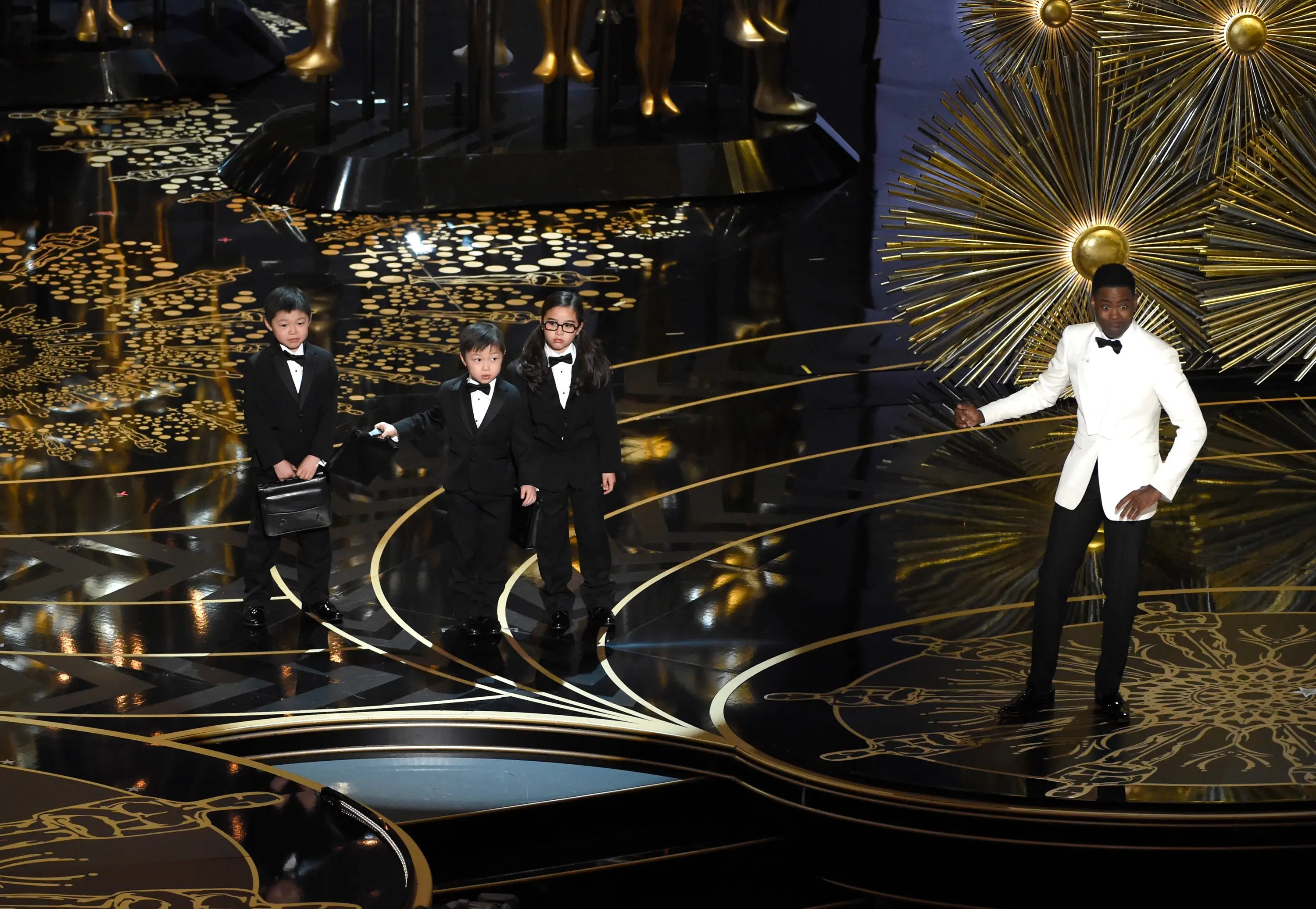 WORST: Chris Rock's low point of the night was when he tried to pull off this bit bringing out Asian children when introducing the accountants who tally the Oscar votes.