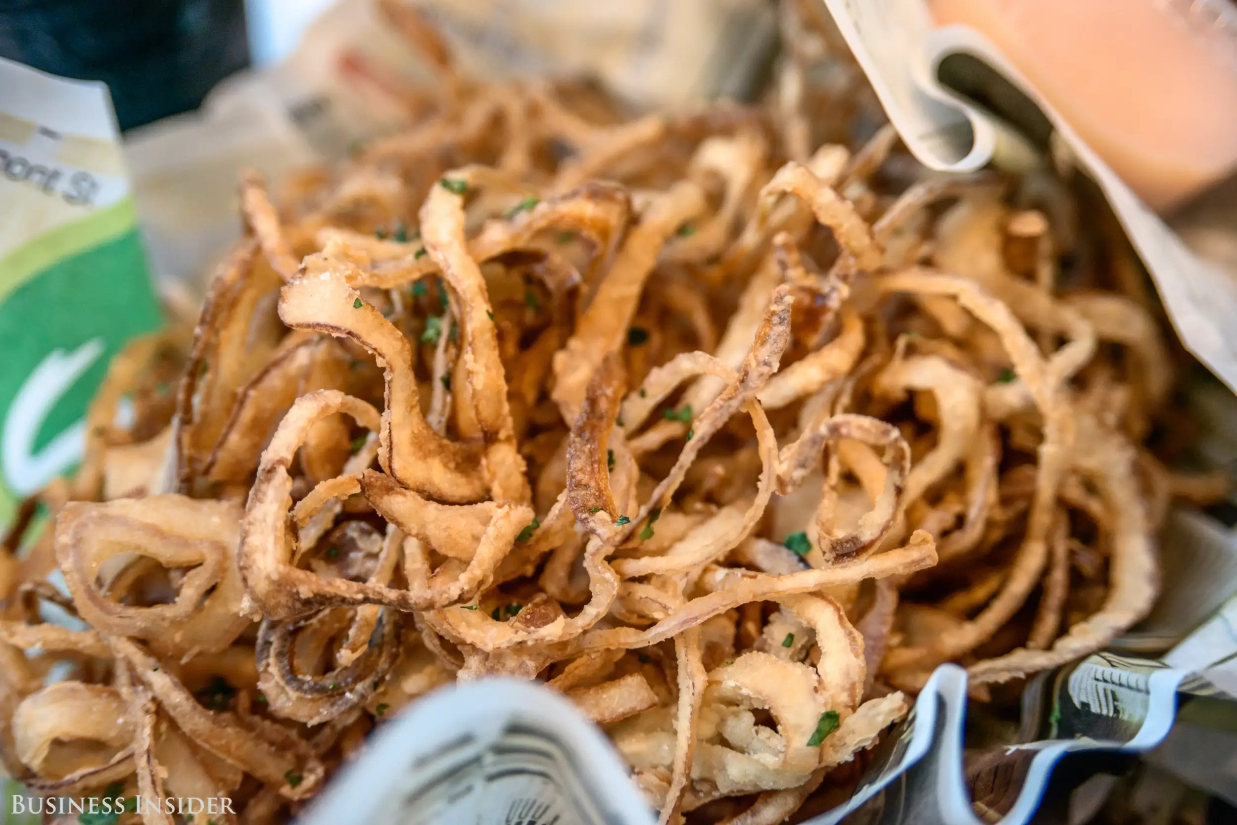 I press onward and start munching on the delicately crispy onion rings, priced at $3.50. They're not so much rings as they are fried onion threads – deliciously crispy and greasy. However, being so thin, they're incredibly difficult to eat and dip in any sauce. These rings are not in the realm of finger foods; rather, a fork is almost mandatory.