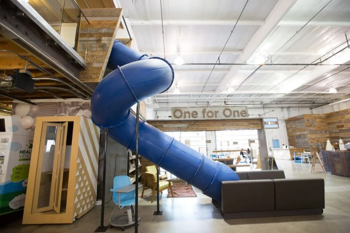 The Toms office in Los Angeles comes with a big blue slide, motivational signs, and all the wood embellishments you could ask for. Another plus: It's totally dog-friendly.