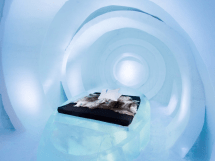 Swedish Ice Hotel Debuts Hand-carved Rooms Stay