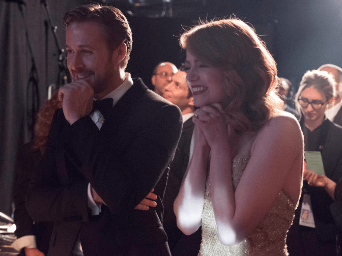"Naturally, Stone was caught backstage giggling with BFF and ""La La Land"" co-star Ryan Gosling."