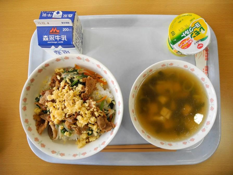 About 25 miles away, Yashima Junior High School offers students rice, pork, and egg; lemon yogurt; tofu seaweed soup; and milk.