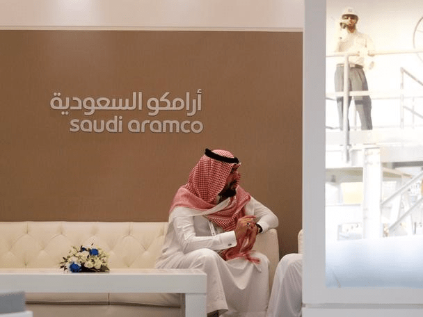 FILE PHOTO: A Saudi Aramco employee sits in the area of its stand at the Middle East Petrotech 2016, an exhibition and conference for the refining and petrochemical industries, in Manama, Bahrain, September 27, 2016. REUTERS/Hamad I Mohammed Saudi Aramco is reportedly leaning towards listing its IPO in New York Saudi Aramco is reportedly leaning towards listing its IPO in New York in aramco ipo pitch canada plays up its natural resources expertise 2017 5